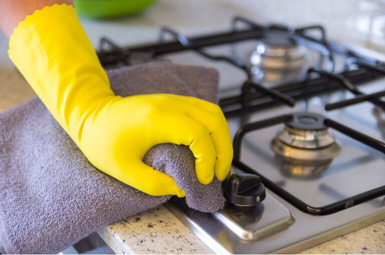 hand cleaning with yellow glove