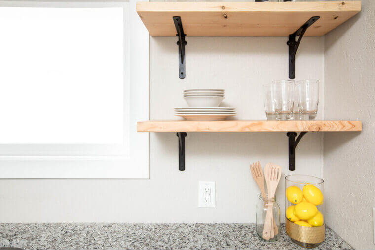 Wooden floating shelves in a modern kitchen space
