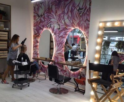 A lady getting tended to in a beauty salon