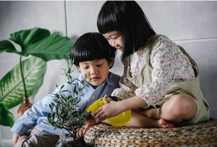 little children enjoying gardening
