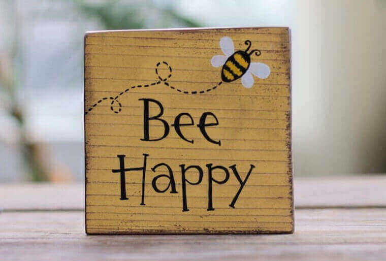Bee Happy sign with bee drawing on the top