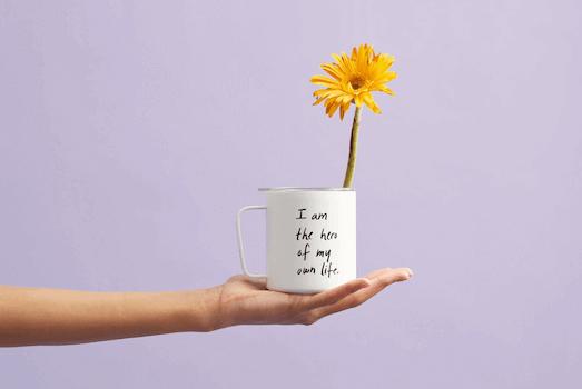 yellow flower in the mug