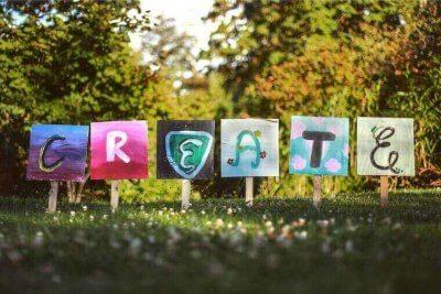 letters c,r,e,a,t,e written on separate boards