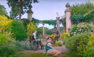 screencap from The Secret Garden film where the three kids are in the secret garden
